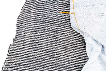 Piece of black jeans fabric isolated on white background. Rough uneven edges. Denim jeans torn. Back side of jeans fabric 版權商用圖片