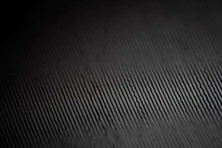 Macro shot of black vinyl record. Surface of an old vinyl record. Shallow deph of field. 版權商用圖片