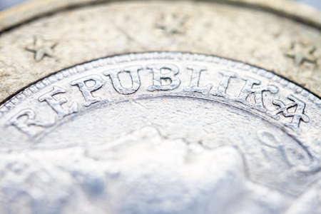 Two euro coin macro detail with Republika word. Latvian 2 euro coin macro view. European currency extreme close up. Shallow depth of field. 版權商用圖片