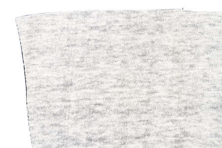 Piece of artificial leather isolated on white background. Back side.