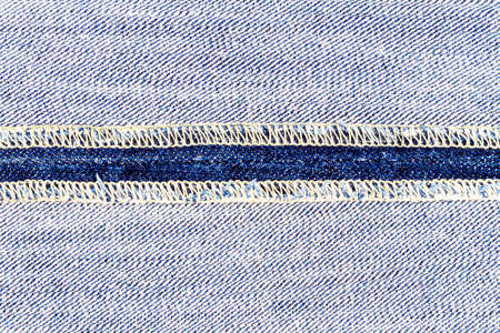 Wrong side of jeans fabric with back seam