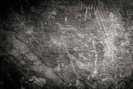 Scratched dirty dusty copper plate texture, old metal background. Cloudy and scratchy brass. Black and white image.