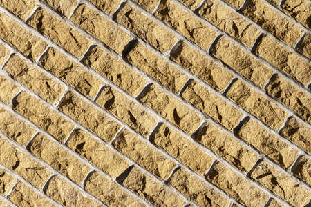 Background of old yellow brick wall texture, abstract horizontal architecture wallpaper 免版税图像