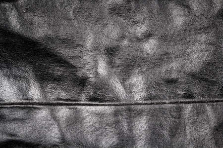 Crumpled black leather texture background. Abstract texture of leather.