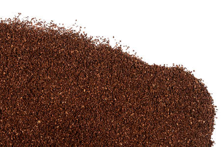 Pile of fresh ground coffee isolated on white background