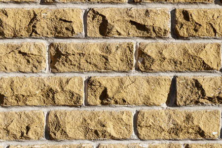Background of old yellow brick wall texture, abstract horizontal architecture wallpaper Reklamní fotografie