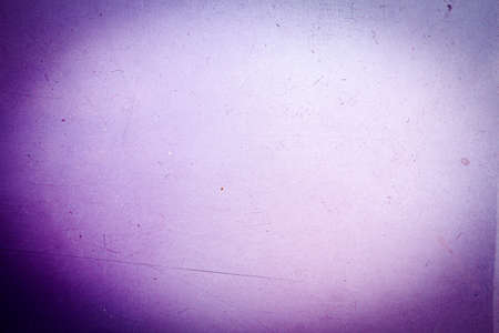 Abstract blue and purple scratched film texture background with heavy grain, dust and light leak