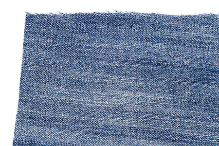 Piece of blue jeans fabric isolated on white background. Rough uneven edges.
