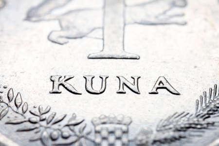 A fragment of croatian metal coin macro photo of one kuna. Selective focus.