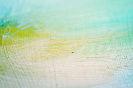 Extreme close up of colorful acrylic paint texture showing brush strokes. Selective focus.