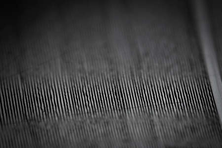Macro shot of black vinyl record showing scratches. Surface of an old vinyl record. Shallow deph of field.