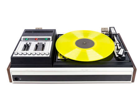 Vintage turntable vinyl record player with yellow vinyl isolated on white background. Foto de archivo