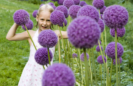 little girl with decorative onion flowers Stock Photo - 4339352