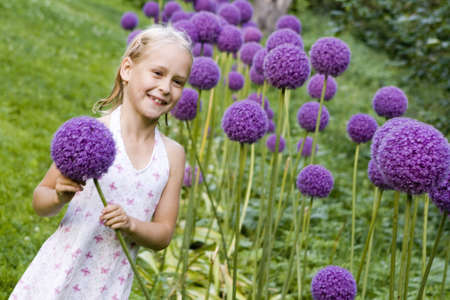 little girl with decorative onion flowers photo