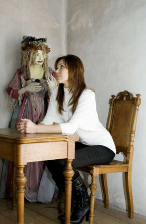 Woman on backdrop of antique wooden sculpture Stock Photo - 4499656