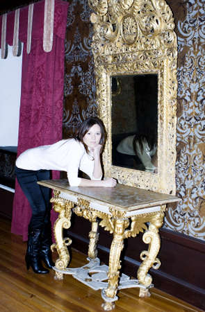 splendid: Woman in a castle on backdrop of antique interior