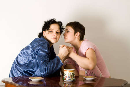 friends having tea series: girl telling a secret to another - gossip  Stock Photo