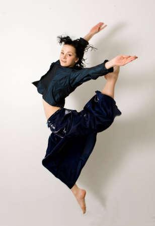 jumping smiling girl. isolated on white background photo