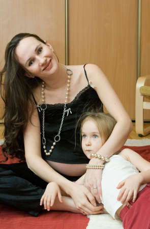 Pregnant Woman with child photo