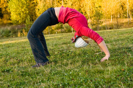 brunete: Young nice blond woman during fitness outdoor Stock Photo