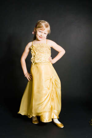 portret of little girl in yellow dress Stock Photo - 6116221