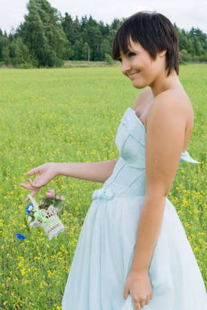 happy young woman in wedding dress on field in summer Stock Photo - 6229745