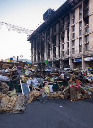 riots: Ukraine, Kiev - April 4: barricada and burned Trade union Center in Kiev at Maidan (Independence Square) 2014.04.04