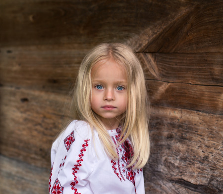 Wonderfull little blonde girl in ukrainian national costume - close up portrait Stock Photo
