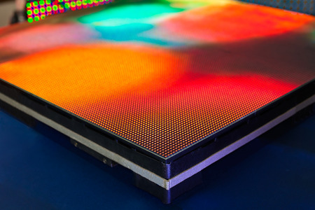Side of the panel of LED screen with bright rainbow colors - blurred background