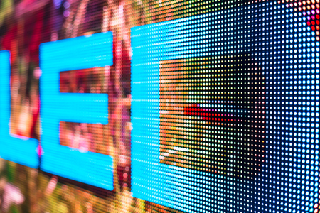 the light emitting: Bright colored LED sign at the LED smd screen - close up background Stock Photo