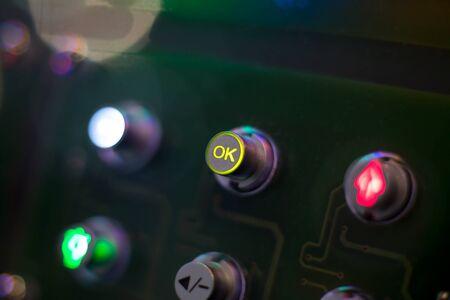 ok button: OK yellow button of the control panel - macro blured background Stock Photo