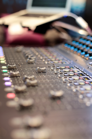 slider: One slider of the stage controller - blurred closeup background Stock Photo