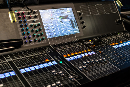 Large modern sound show controller panel with screen and presets - side view Stock Photo