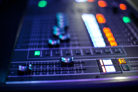 slider: Blurred panel of the stage controller with slider - closeup background