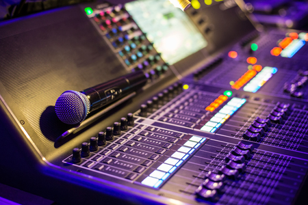 Large modern show sound controller with microphone on it - close up photo Stock Photo - 58558335