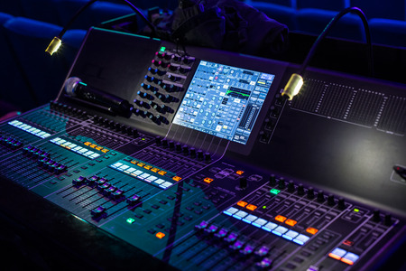 Large modern show sound controller with lighted screens and ajusted presets - close up photo Stock Photo - 58558384