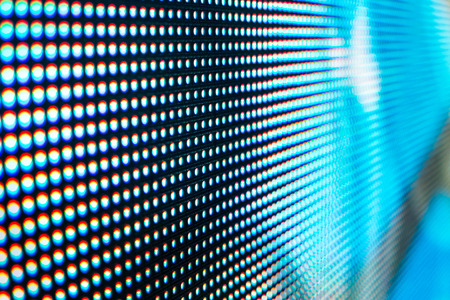 video wall: Bright colored LED video wall with high saturated pattern - close up background with shallow depth of field Stock Photo