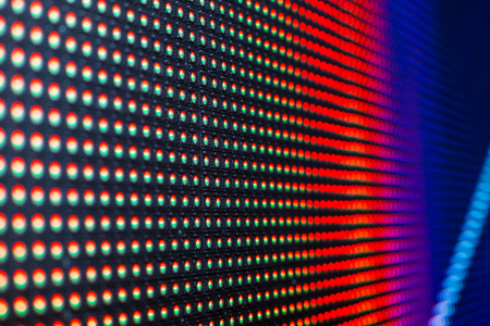 Bright colored LED video wall with high saturated pattern - close up background with shallow depth of field Stock Photo