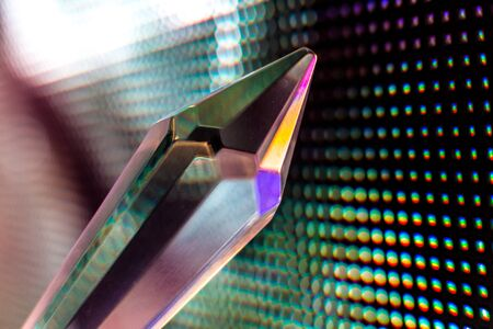 Bright colored stone crystals on the LED wall background  - close-up macro photo Stock Photo