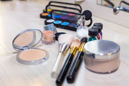 Different makeup items on the table - product photo with shallow depth of field. Stock Photo