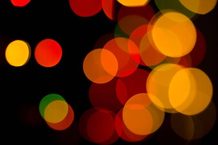 Colored bokeh textures - abstract photo on the black background for adding and editing as the background layer in the multiply regime