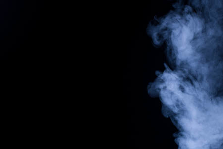 Smoke vape vapor texture for designers works - abstract photo texture of the real smoke on the black background for adding and editing as background layer in the screen regime