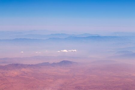 Desert mountains of Iran with clouds - morning aero-photo.