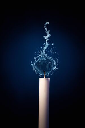 One candle that burns with water splash. Conceptual ecological and nature photo against the forest fires.