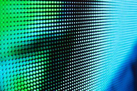 Helle farbige LED-Videowand mit stark gesättigtem Muster - Nahaufnahme Hintergrund mit geringer Schärfentiefe Standard-Bild