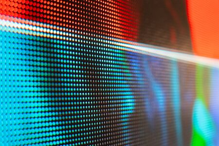 Bright colored LED video wall with high saturated pattern - close up background with shallow depth of field Фото со стока - 131607316