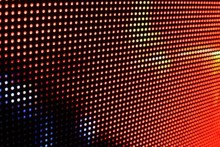 Bright colored LED video wall with high saturated pattern - close up background with shallow depth of field Фото со стока - 131607653