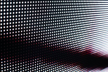 Bright colored LED video wall with high saturated pattern - close up background with shallow depth of field Фото со стока - 131635450