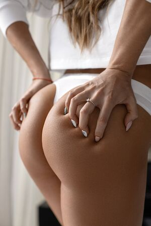 Ideal woman's fitness butt and hips - sport and perfect anti-cellulite and skin care therapy program. 免版税图像