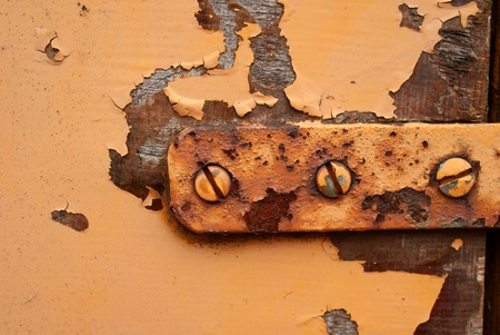 Macro shot of an old rusty door hinge  photo